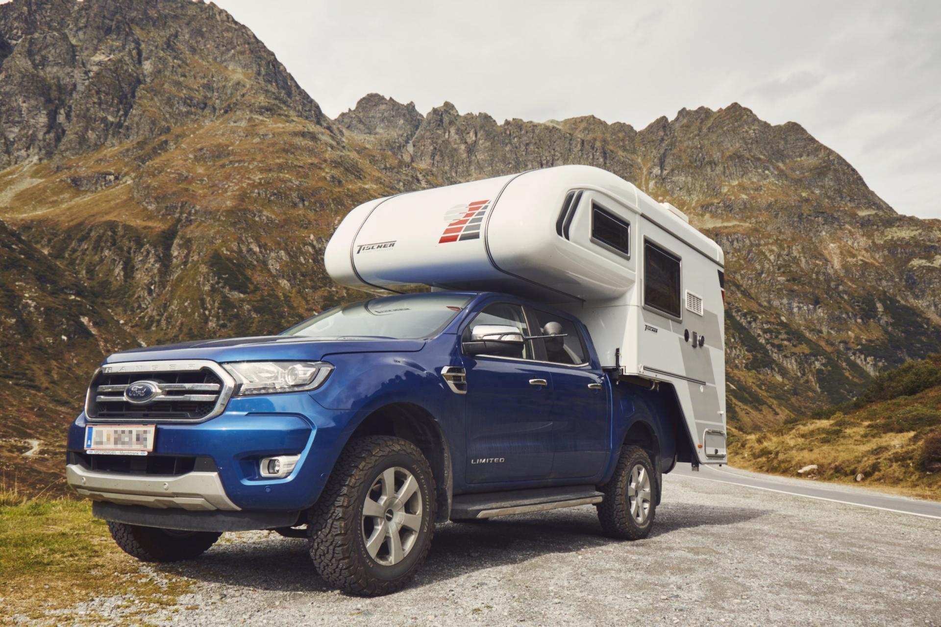 Wir haben einen Pickup Camper gekauft! Auf unserem blauen Ford Ranger thront eine Tischer 230S Wohnkabine und macht den Pickup Camper komplett